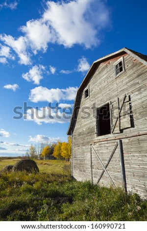 An old weathered vintage barn abandoned on the prairies - stock photo