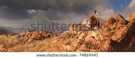 An old west scene of a cowboy riding his horse, with a rainstorm off in the distance. - stock photo