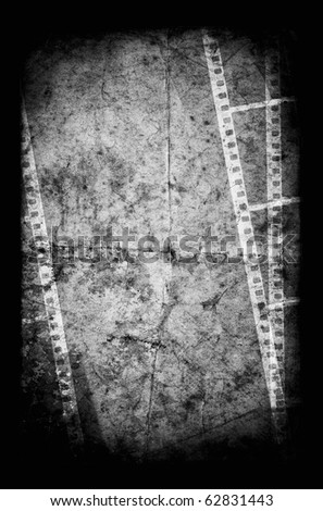 An old white film frame on an old grunge paper - stock photo