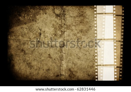 An old white film frame on an old grunge paper