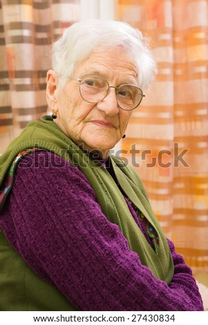 An old woman looking at the camera.