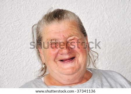 An old woman with good funny face - stock photo
