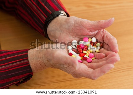 An old woman with tablet - stock photo