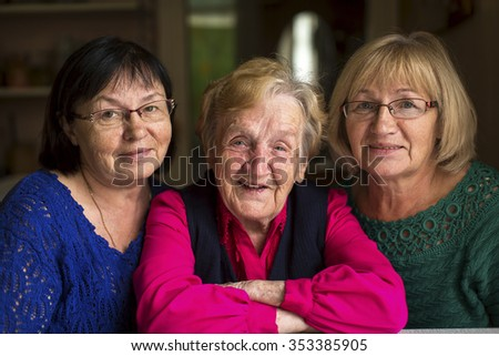 An old woman with two adult daughters. - stock photo