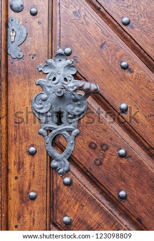 an old wood door with metal handle