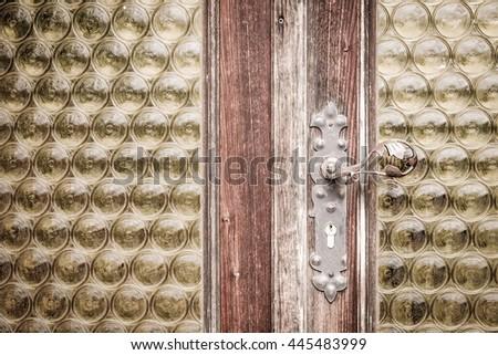 an old wood door with metal handle - stock photo