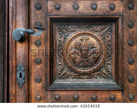 an old wood door with metal handle - stock photo