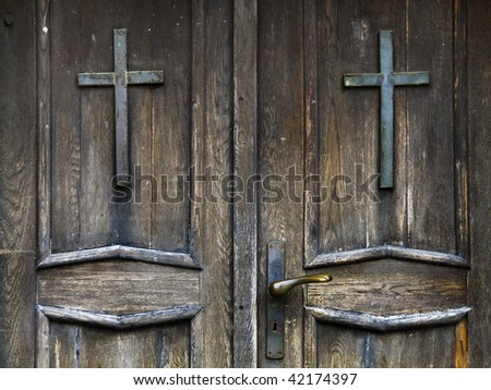 an old wood door with metal handle  and two cross - stock photo