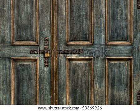 an old wood door with metal padlock - stock photo