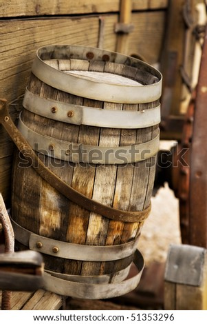 An old wooden barrel in attached to the side of a wagon from the old west. - stock photo