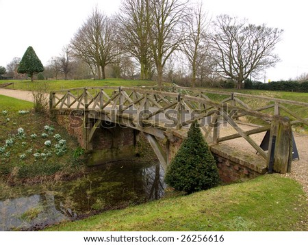 An old wooden bridge across a river