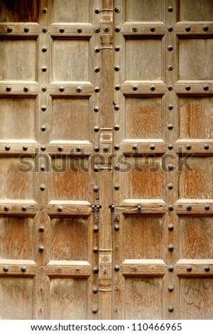 An old wooden door at Old Fort, New Delhi. - stock photo