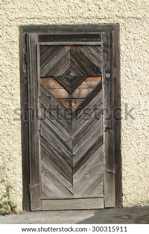 An old wooden door in a wall - stock photo