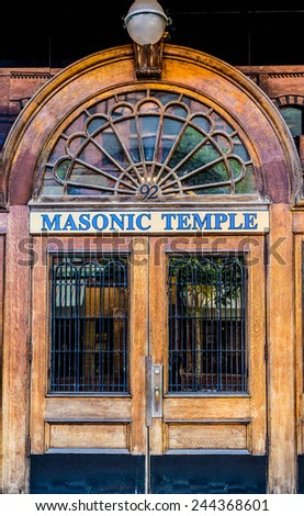 An old wooden door with iron bars on a Masonic Temple in St Johns, Canada - stock photo