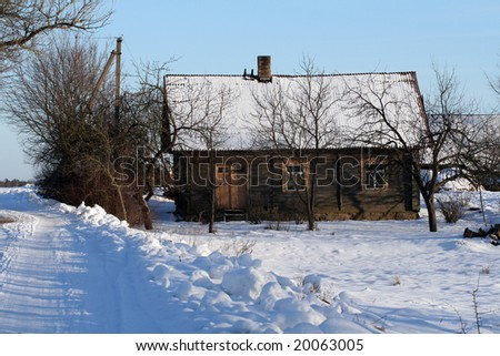 An old wooden house in winter - rural landscape, Lithuania