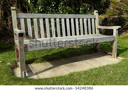 An old wooden park bench. - stock photo