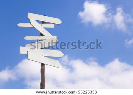 An old wooden signpost with blank arrows for you to add your own text - stock photo