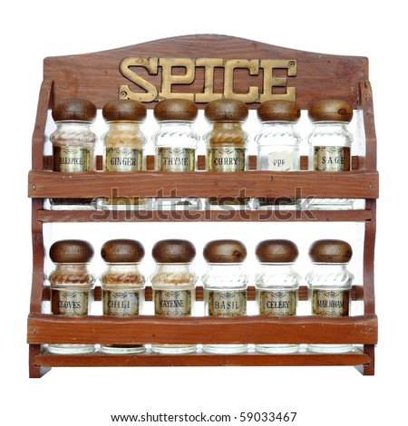 An old wooden spice rack isolated on white background. Most of the bottles are empty. - stock photo