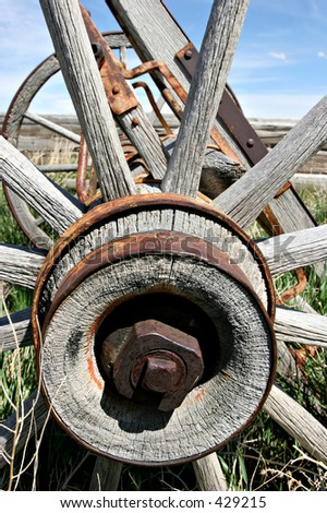 an old wooden wagon wheel in wyoming - stock photo