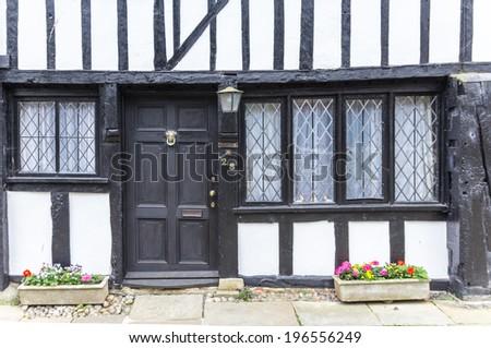 An old wooden with black door house seen in Rye, Kent, UK. - stock photo