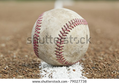 An old worn baseball - stock photo