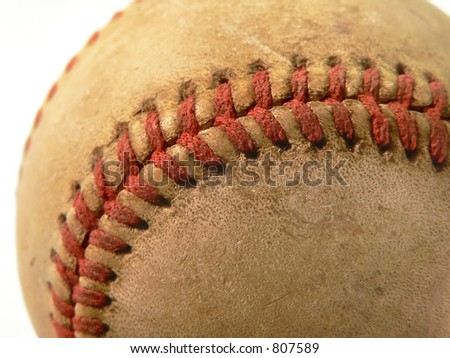 An old worn baseball isolated on white background
