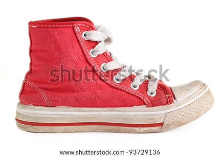 An old worn pair of children's sports shoes/trainers. - stock photo