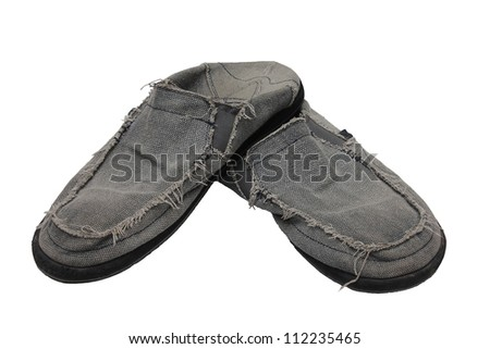 An old worn pair of shoes. - stock photo