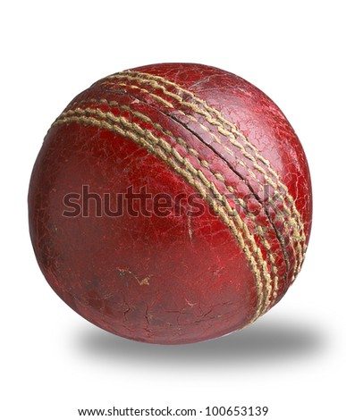 an old worn used cricket ball isolated on white with clipping path - stock photo