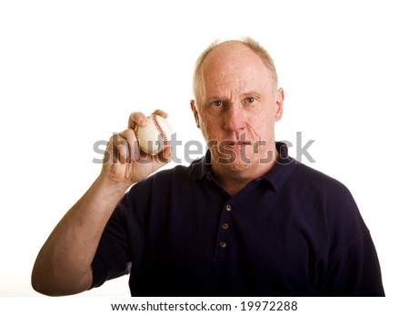 An older bald man holding a baseball
