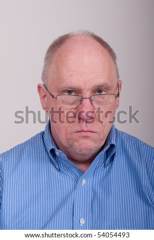 An older balding man in a blue shirt