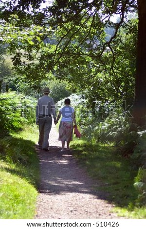 An older couple out for a walk - stock photo