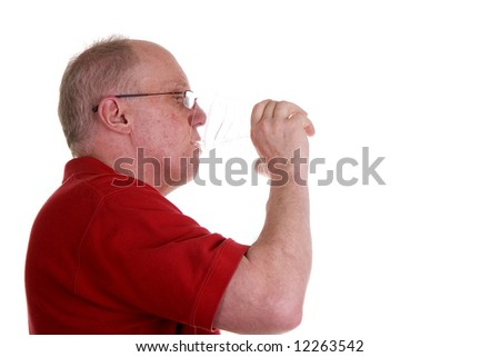 An older guy drinking water from a clear cup on a white background