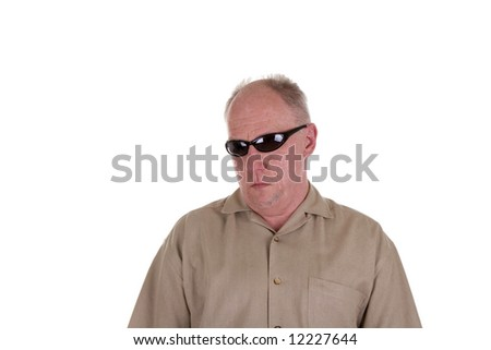 An older guy in a brown shirt wearing wrap around sunglasses