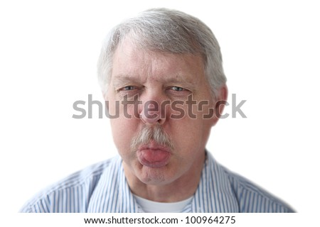 an older man blows a raspberry in a rude gesture