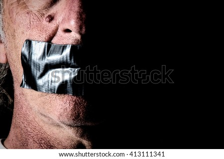 an older man's mouth is covered and taped closed with duct tape, side lit with half of face in shadow, and highly detailed. - stock photo