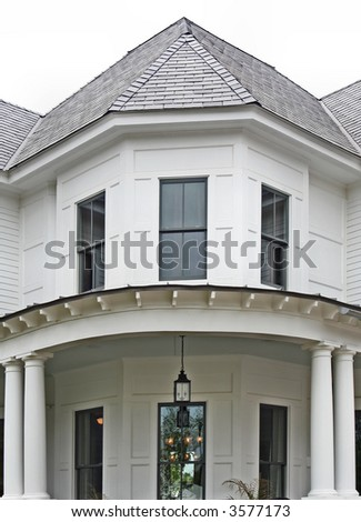 An older style home facade in early evening on a hazy day in the South. - stock photo