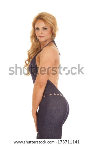 An older woman in a pantsuit with her back showing. - stock photo