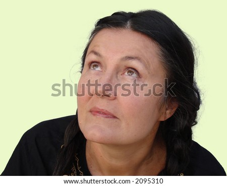 An older woman looking up at the heavens - stock photo