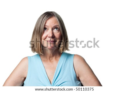 An older woman looks to the heavens - stock photo
