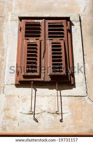 An oldstyle mediterranean window with closed panels from croatia.