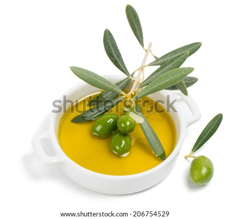 An olive branch with green olives in olive oil isolated on a white background.