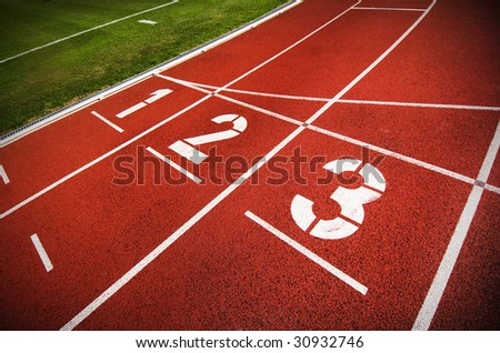 An Olympic running track - stock photo