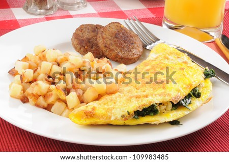 An omelet with potatoes OBrian and sausage closeup - stock photo