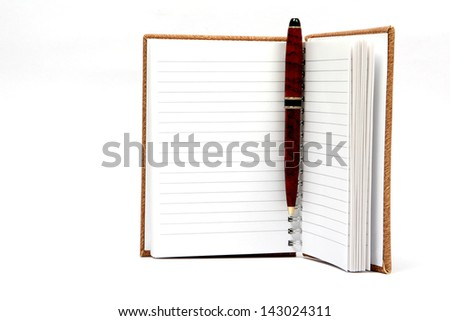 An open agenda or notebook and a pen on white. - stock photo
