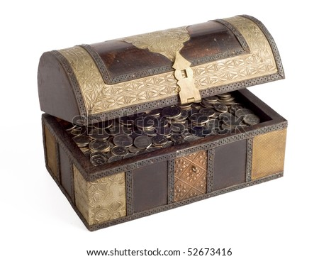 An open, antique trunk filled with UAE Dirhams - stock photo