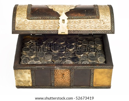 An open, arabic trunk filled with UAE Dirham coins. - stock photo