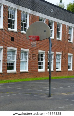 An open basket ball court in an old school - stock photo