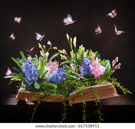 An Open Bible With Beautiful Flowers And Butterflies Coming Off The Pages