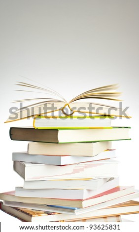 An open book on a stack of books